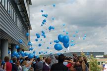 Helium ballonnen oplaten bij opening nieuw pand